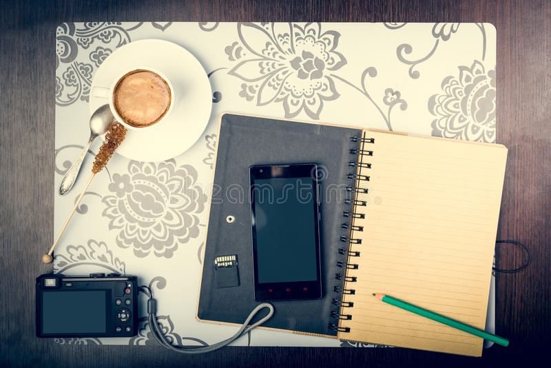Jourey planning concept. Notepad, cup of coffee, smartphone and digatal capera on the desktop. Journey planning concept royalty free stock photography