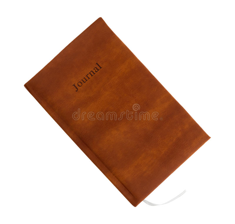 Journal on a white background. Top view of a brown leather journal isolated on a white background royalty free stock photos