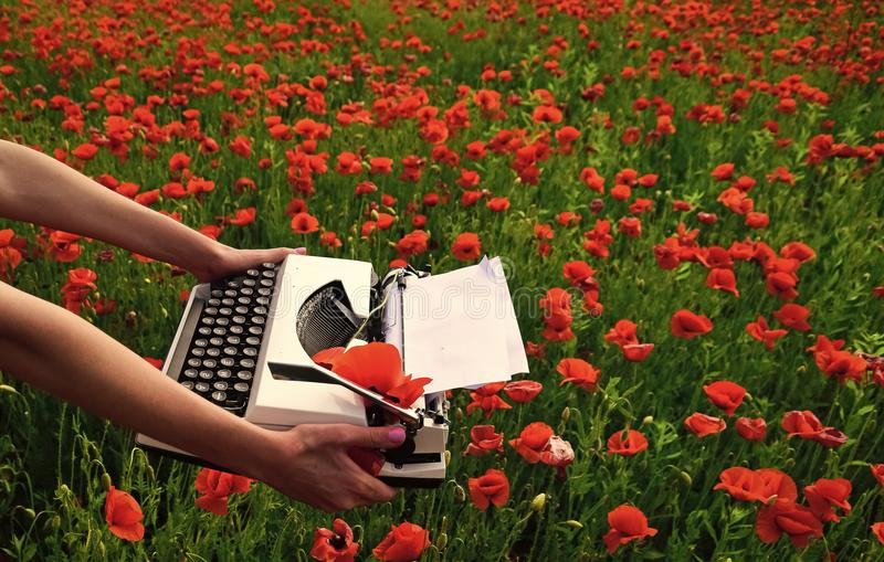 Journalism and writing summer. Opium poppy, agile business, ecology. Drug, narcotics, opium, novel. Poppy, new technology, Remembrance day Vintage typewriter royalty free stock photo