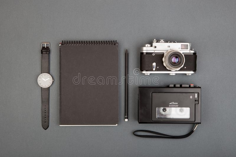 Journalist or blogger table - spiral blank notebook, pencil, cam stock photo