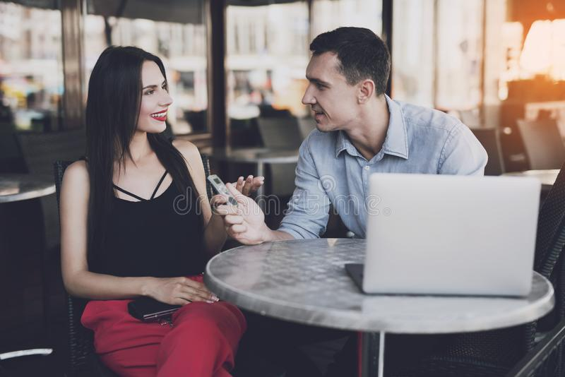 A journalist interviews a business lady. A reporter at work. In the cafe a journalist sits at a round table and writes down the answers of the girl to the royalty free stock image