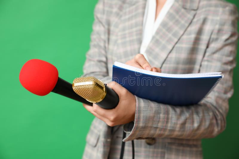 Journalist with microphones and notebook on background, closeup stock image