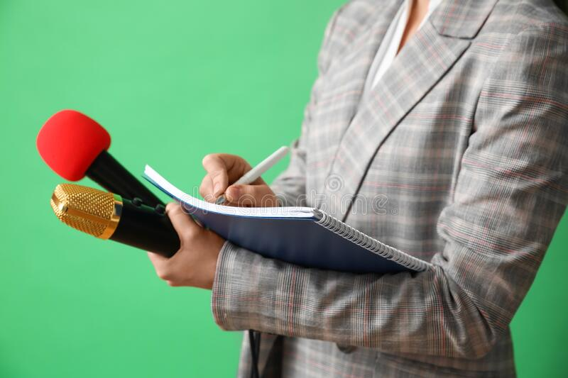 Journalist with microphones and notebook royalty free stock photos