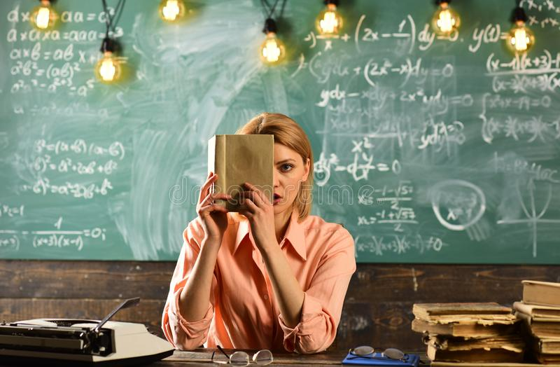 Journalist working with documents. Journalist woman hold book for getting information. stock photography