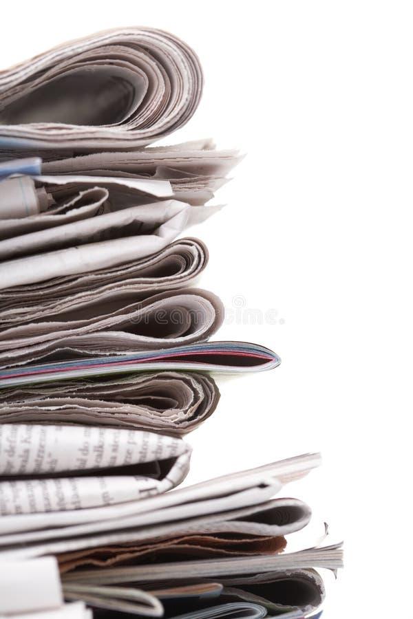 Journaux, vue de côté photos stock