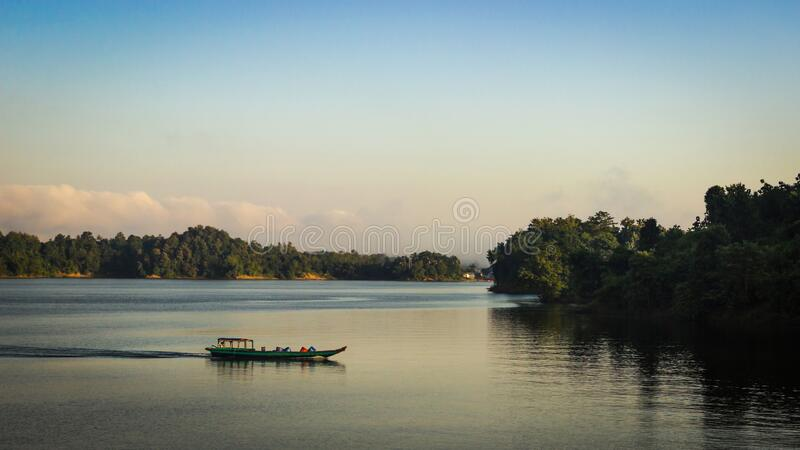 Journey by boat in Kaptai lake in a tranquil morning in Bangladesh stock images