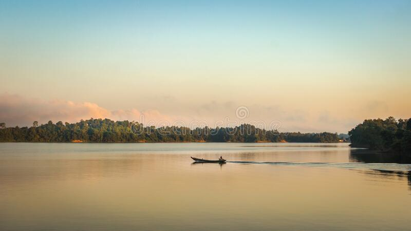 Journey by boat in the tranquil Morning  in Kaptai Lake in Bangladesh royalty free stock photo