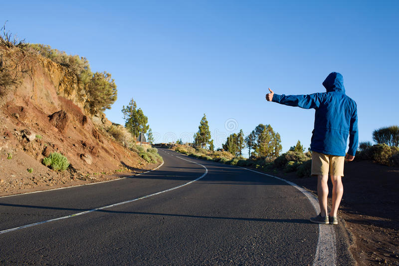 Journey of hitch-hiker stock photography