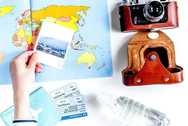 Journey planning with tourist outfit on white table background t stock image