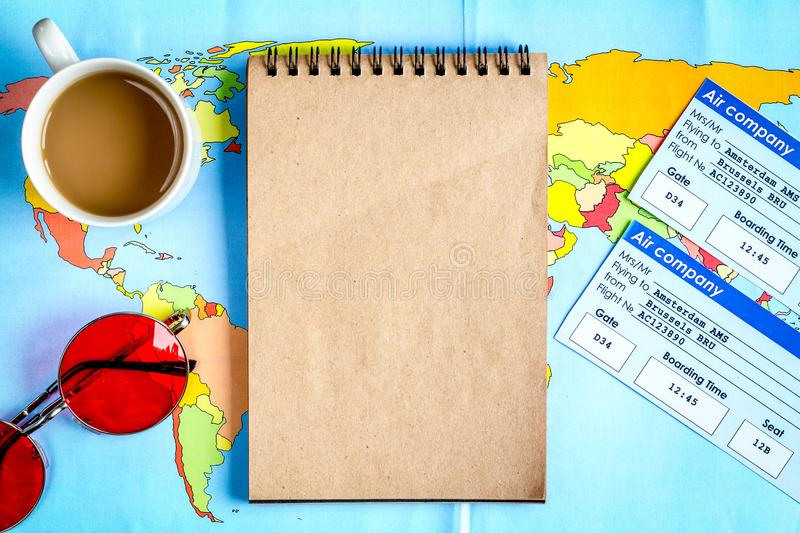 Journey planning with tourist outfit on wooden table background royalty free stock image