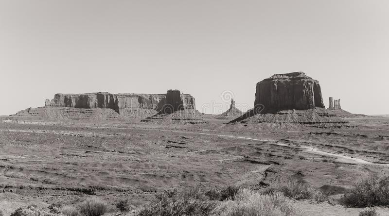 Sandy road in the Valley of Monuments. Traveling in Arizona. Natural Attractions of North America. Journey to the southwest of the USA. Panorama of the Valley of royalty free stock image