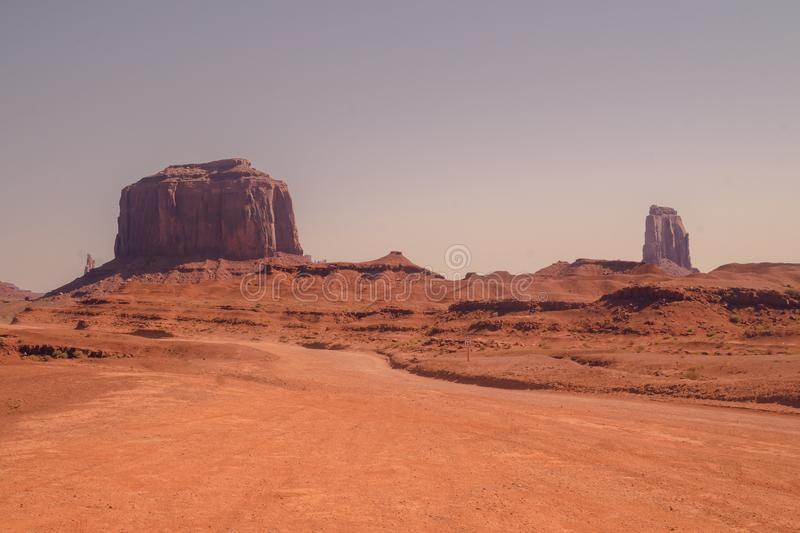 Journey to the wild West of the USA. Road in the rocky desert of the Valley of Monuments. Journey to the southwest of the USA. Panorama of the Valley of stock photography