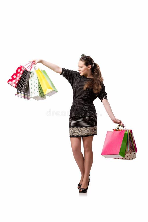 A jovem mulher após a compra isolada no branco fotografia de stock royalty free