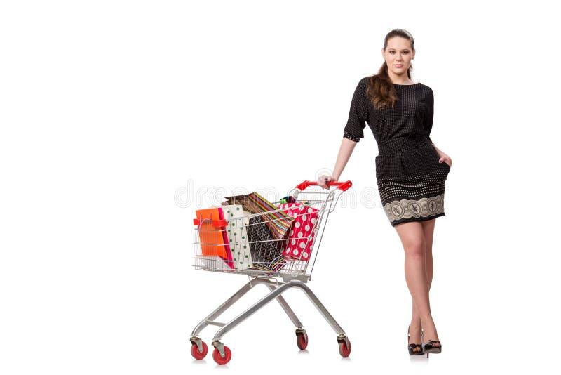 A jovem mulher após a compra isolada no branco imagem de stock