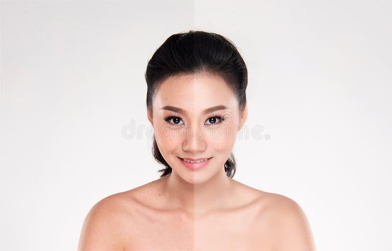 Jovem mulher asiática bonita no fundo branco fotografia de stock royalty free