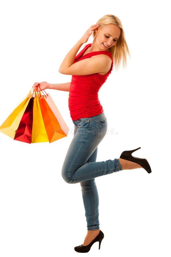 Jovem mulher bonita com sacos de compras ov isolado consumição fotos de stock