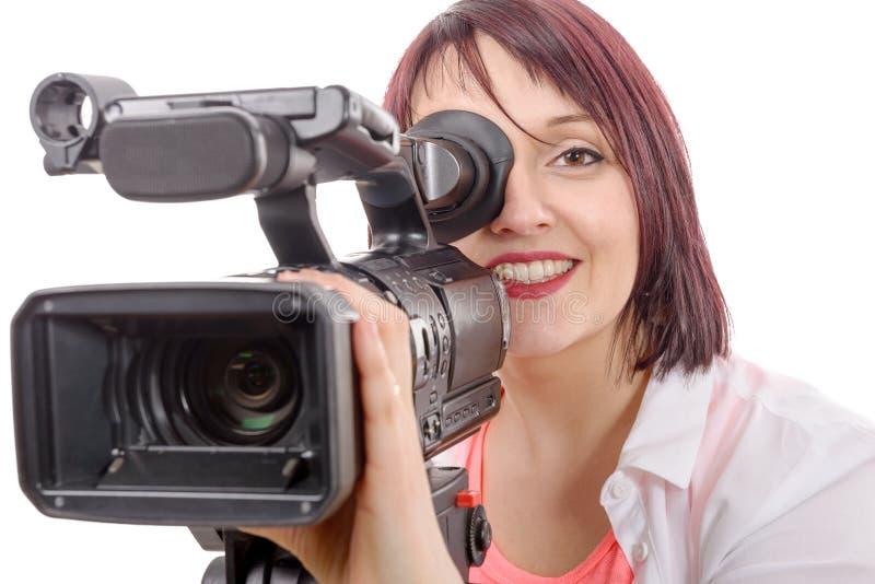 Jovem mulher bonita com uma câmera profissional imagens de stock royalty free