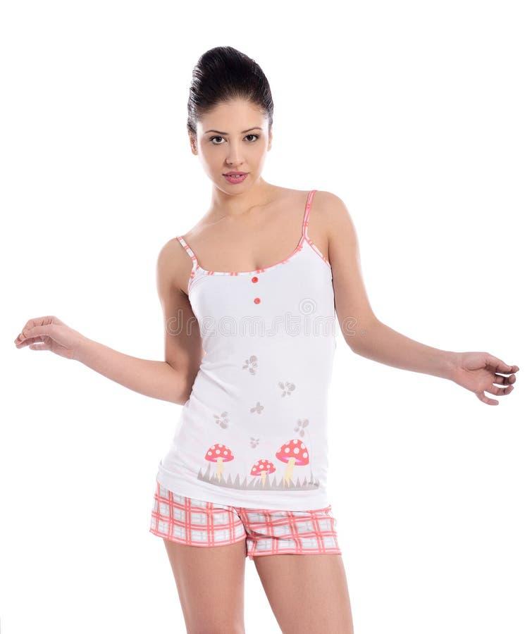 Jovem mulher bonita no pyjama fotos de stock royalty free