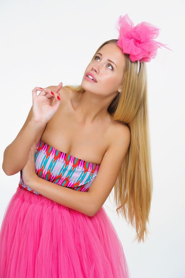 Jovem mulher bonita no rosa imagem de stock royalty free