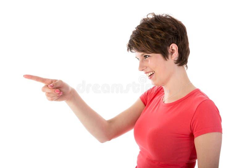 Jovem mulher bonita que aponta com seu dedo imagens de stock royalty free