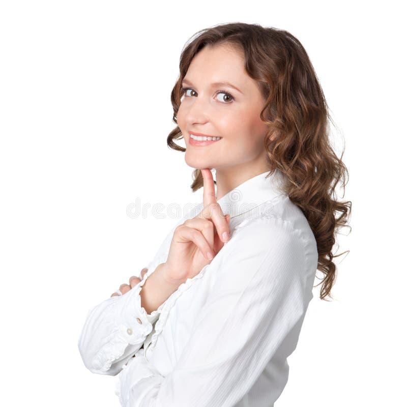 Jovem mulher bonita que daydreaming imagem de stock