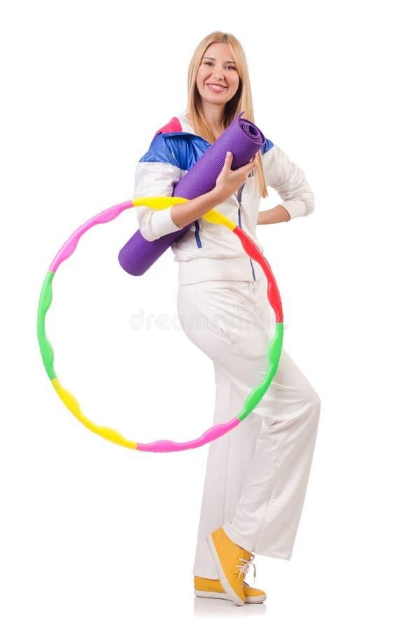 Jovem mulher com aro do hula foto de stock