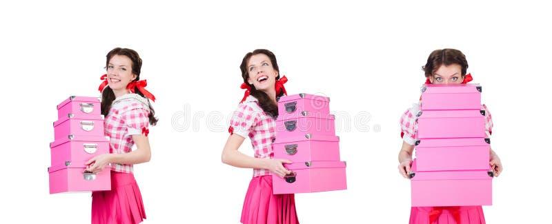 Jovem mulher com as caixas de armazenamento no branco foto de stock royalty free