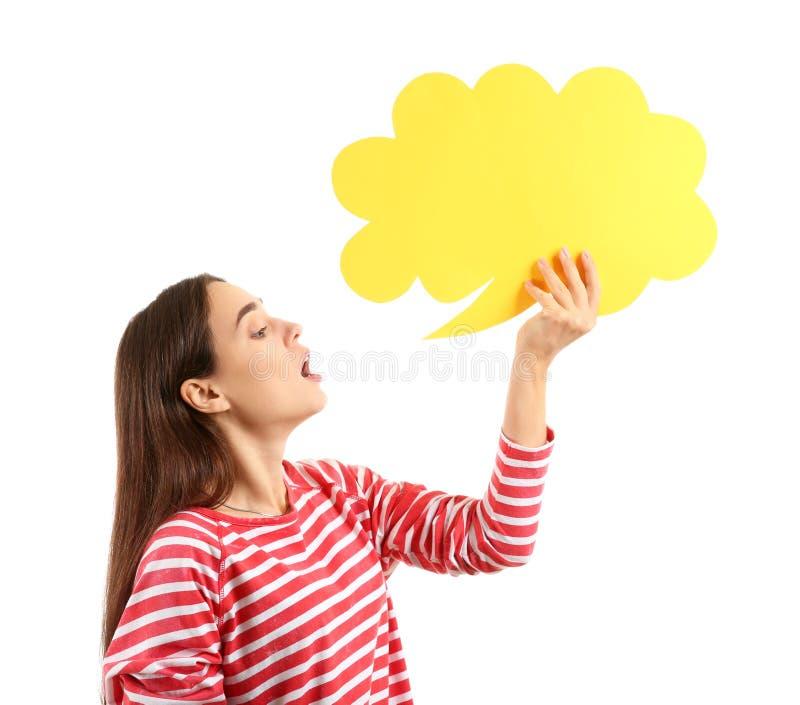 Jovem mulher com bolha vazia do discurso no fundo branco fotos de stock royalty free
