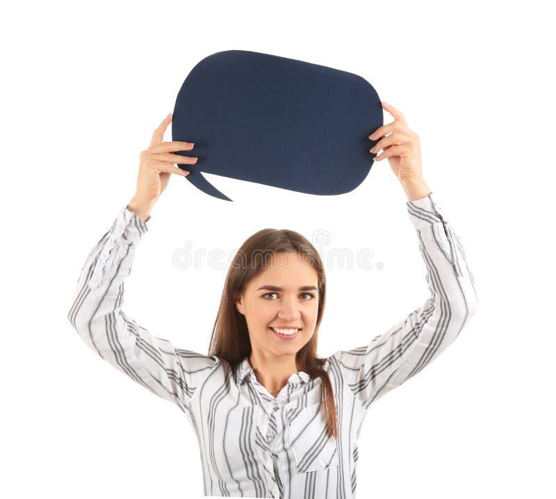 Jovem mulher com bolha vazia do discurso no fundo branco imagem de stock