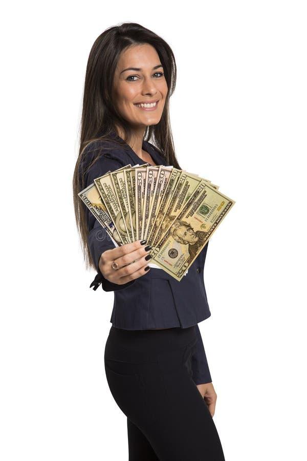 Jovem mulher com dinheiro do dólar em suas mãos fotografia de stock royalty free