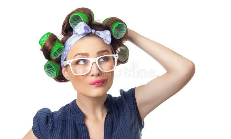 Jovem mulher com encrespadores imagem de stock