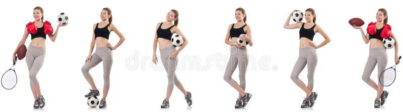 Jovem mulher com futebol, bola de rugby, luvas de encaixotamento e t?nis foto de stock royalty free
