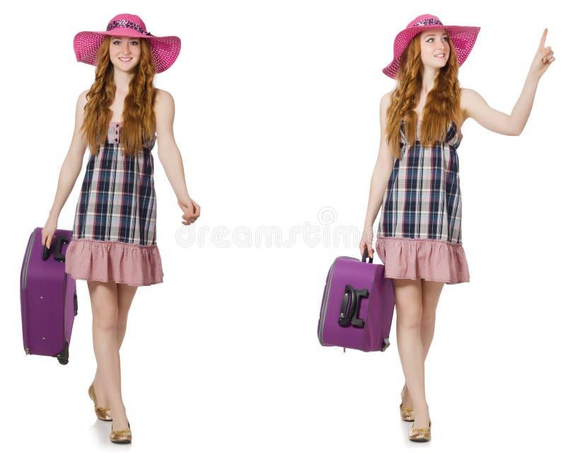 A jovem mulher com a mala de viagem isolada no branco fotos de stock royalty free