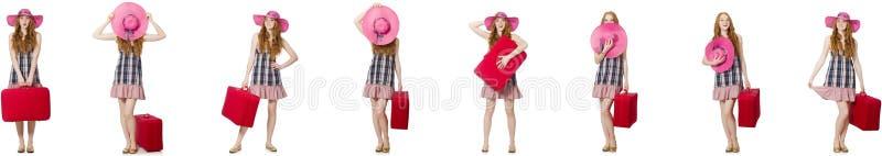 A jovem mulher com a mala de viagem isolada no branco imagens de stock royalty free