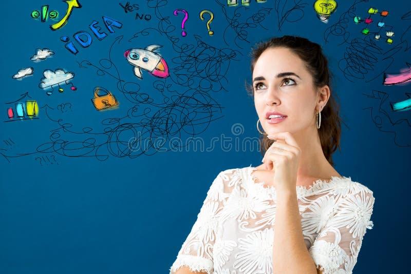 Jovem mulher com muitos pensamentos imagem de stock