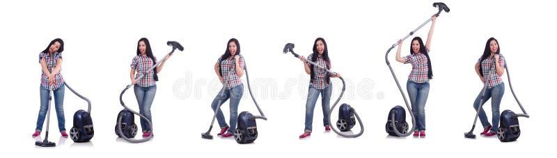 Jovem mulher com o aspirador de p30 no branco foto de stock