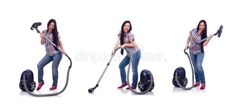 Jovem mulher com o aspirador de p30 no branco imagens de stock