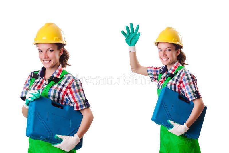 A jovem mulher com o conjunto de ferramentas no branco fotos de stock