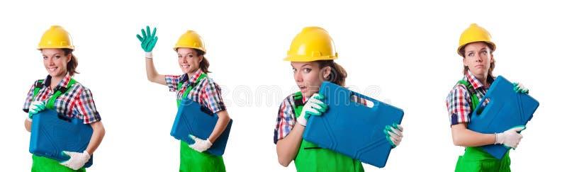 A jovem mulher com o conjunto de ferramentas no branco imagem de stock