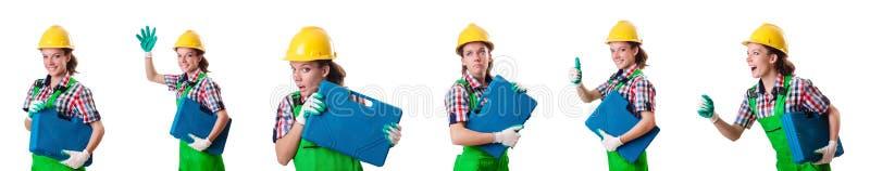 A jovem mulher com o conjunto de ferramentas no branco fotografia de stock royalty free