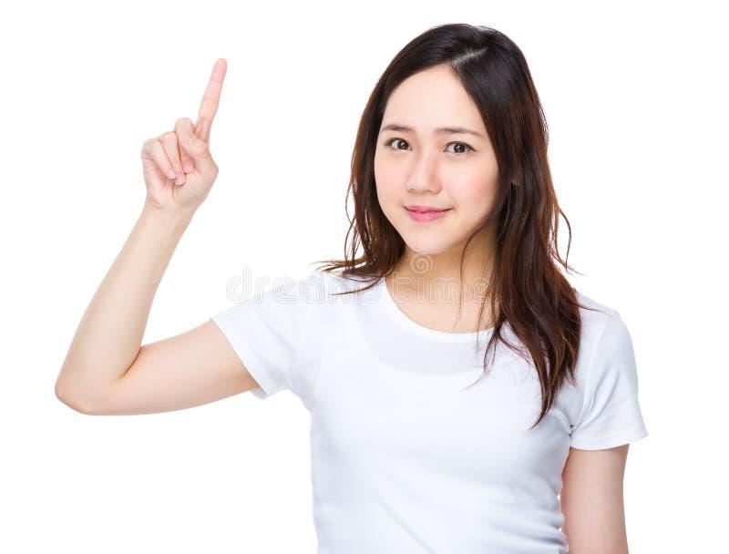 Jovem mulher com o dedo que aparece fotos de stock royalty free