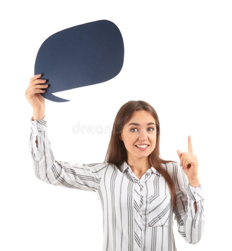 Jovem mulher com o indicador aumentado e bolha vazia do discurso no fundo branco imagens de stock