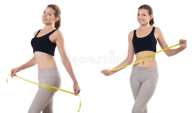 Jovem mulher com o medidor que faz exerc?cios imagem de stock royalty free