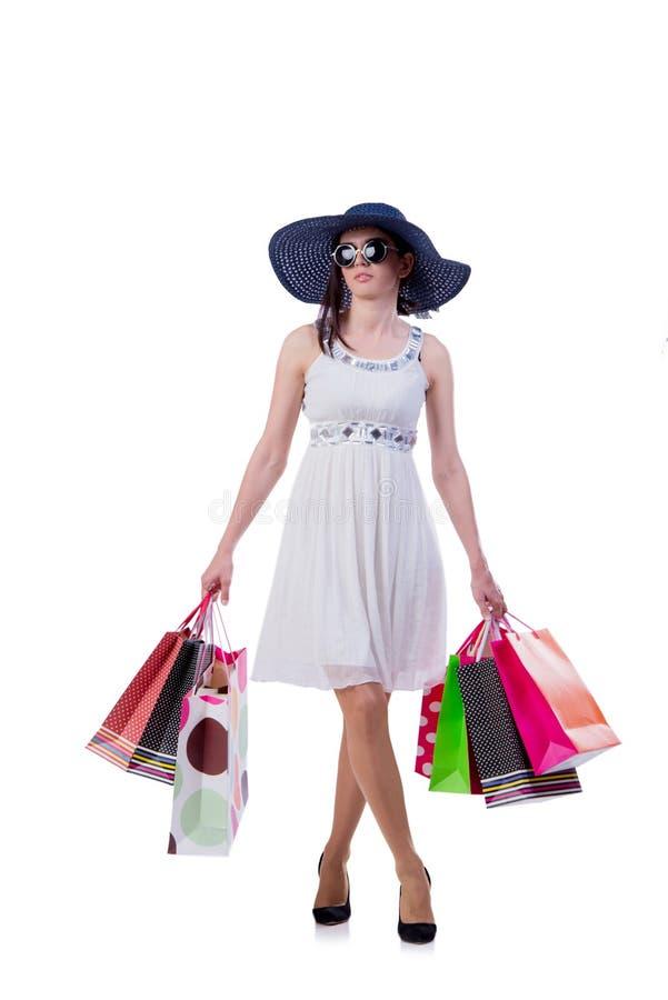 A jovem mulher com os sacos de compras do Natal no branco fotos de stock royalty free