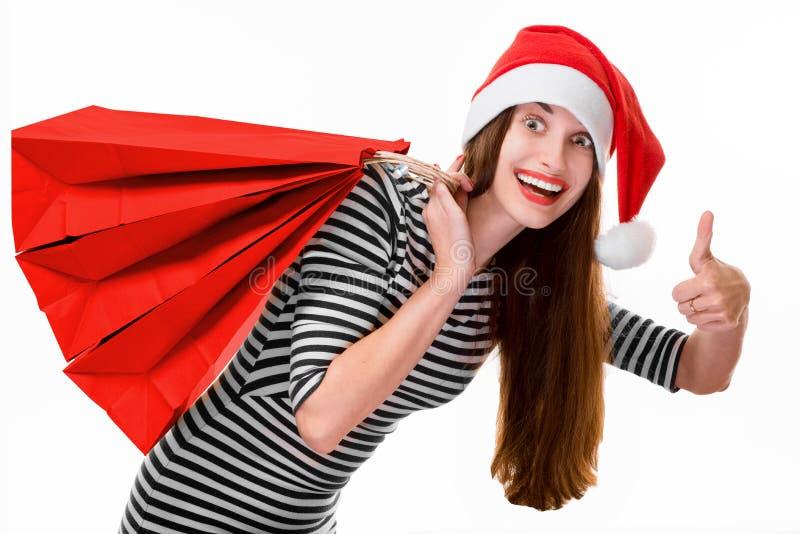 Jovem mulher com os sacos de compras no Natal imagens de stock