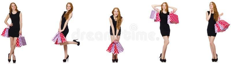 A jovem mulher com os sacos no conceito shopaholic imagens de stock