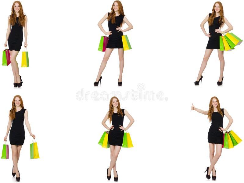 Jovem mulher com os sacos no conceito shopaholic foto de stock royalty free