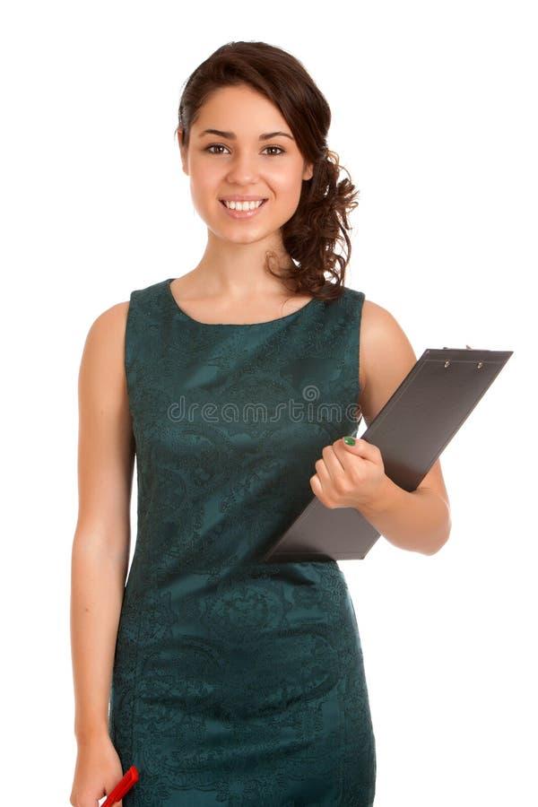 Jovem mulher que guardara a prancheta fotografia de stock