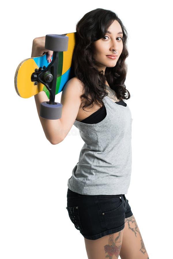 Jovem mulher com um longboard fotos de stock royalty free