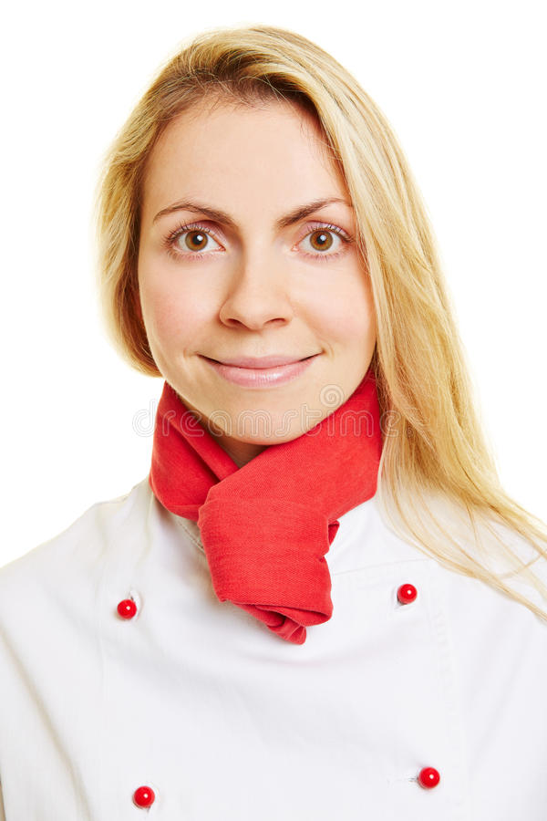 Jovem mulher de sorriso como o cozinheiro do cozinheiro chefe imagens de stock